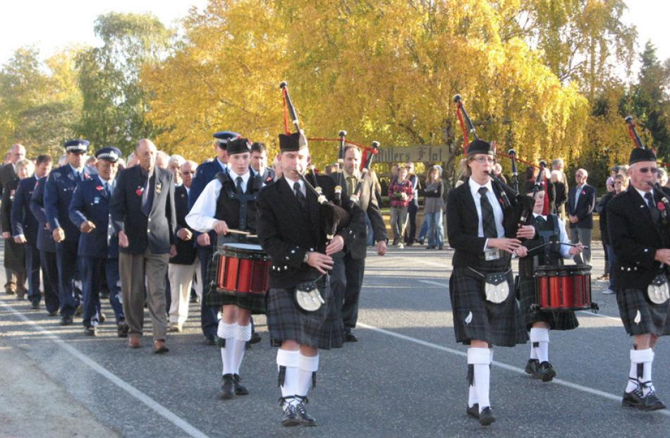 Pipers lead the parade to the war memorial in Millers Flat.