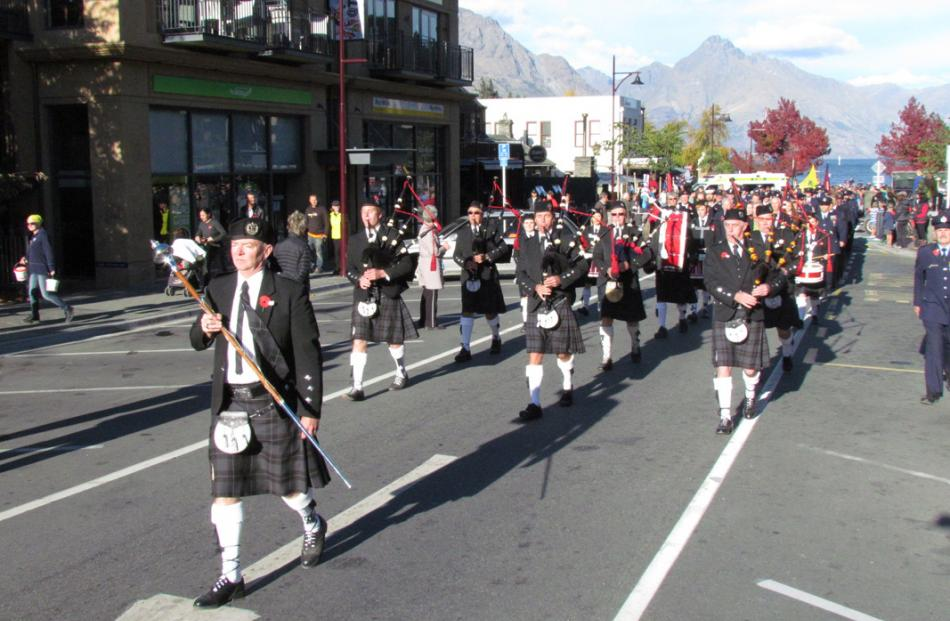 The Queenstown and Southern Lakes Highland Band lead Queenstown's ANZAC parade.