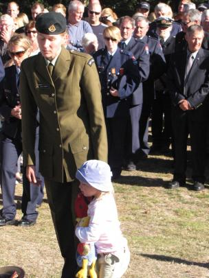 Selma Roberts and daughter Caitlin (2), both of Arrowtown, take part in services at the Arrowtown...