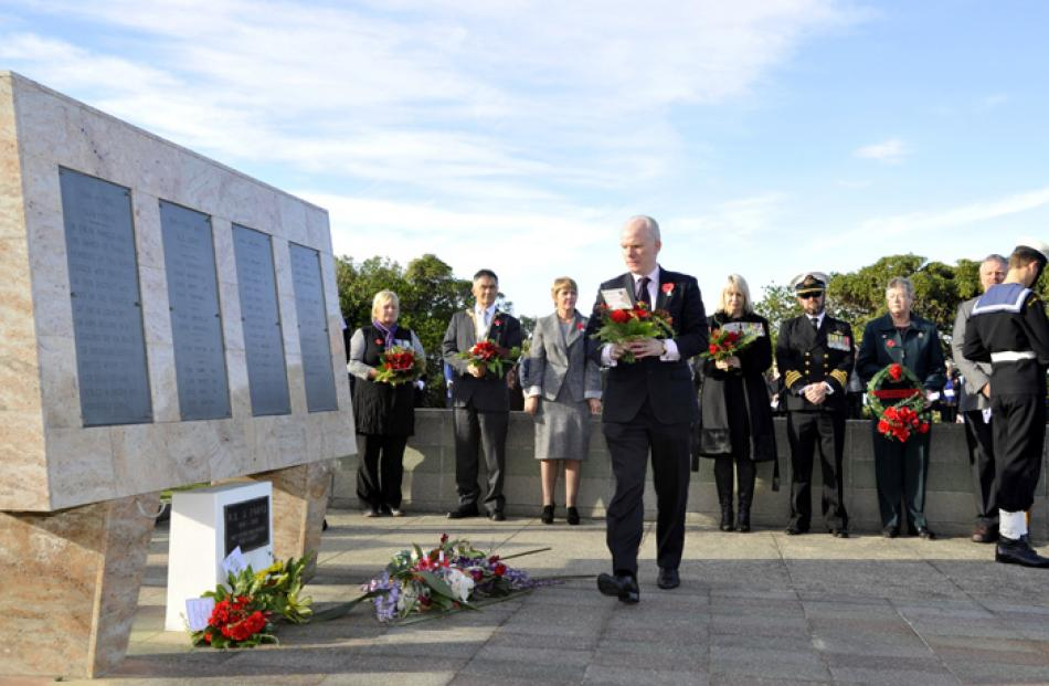 UK Deputy High Commissioner Mr Patrick Reilly, lays a wreath at Andersons Bay Cemetery in Dunedin.