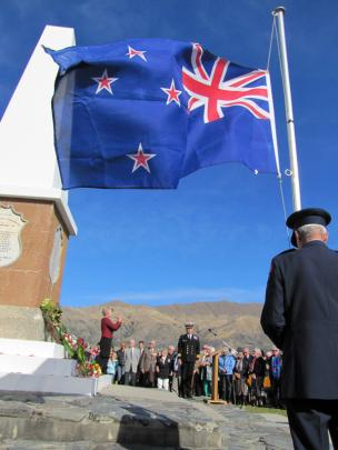 Jackie Hamilton, of Cromwell, plays the Last Post, while Queenstown Lakes deputy mayor Commander...