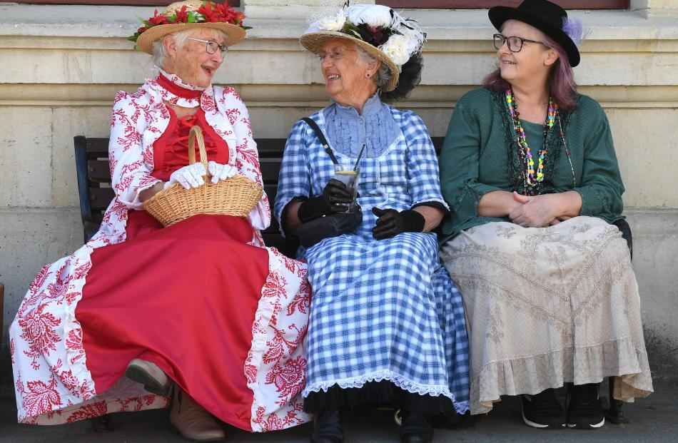 Waiting for the parade to start are (from left) Jule Norris, of Mosgiel, June Simpson, of...