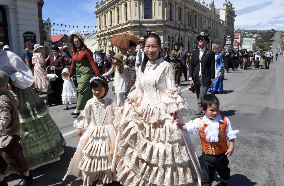 Mother Vivian Huang and children Charlotte (6) and Harrison Jin (4), of Christchurch, take part...