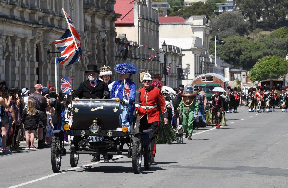 Gordon and Wendy Pringle, of Oamaru, escort Julie Clark, as Queen Victoria, in their replica 1901...