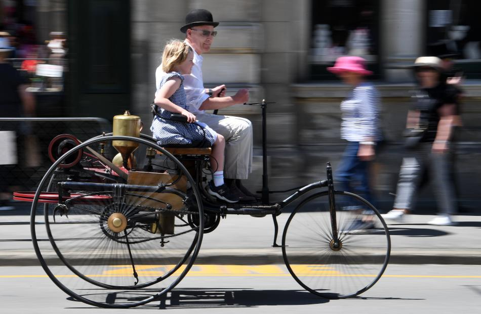 Labour MP David Clark, and daughter Clara (7), take a ride in a replica 1886 Benz.