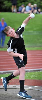 Lee Stream School's George Tisdall (12) throws in the boys under-13 shot put.
