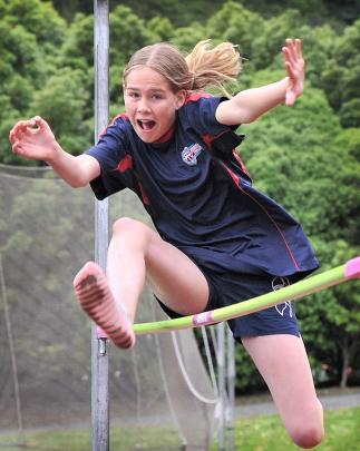 Kavanagh College's Anamika Jones (13) attempts to clear the bar in the girls under-13 high jump.