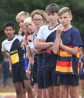 Boys in the 13+ long jump await their turn.