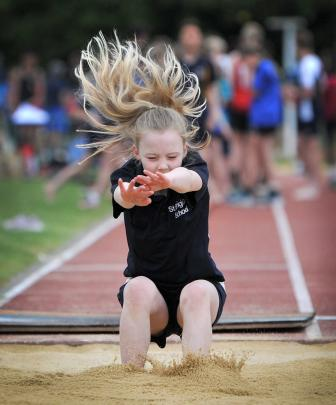 St Brigid's School's Madison Bryce (9) lands in the girls under-10 long jump.
