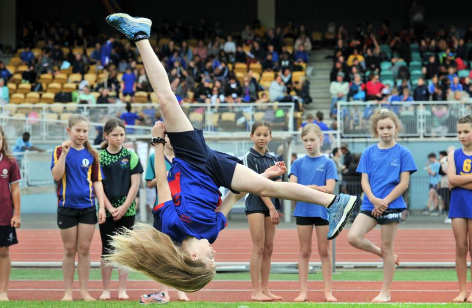 Scarlett Gillanders (9), of Abbotsford School, fills in time by doing an ''aerial'' while waiting...