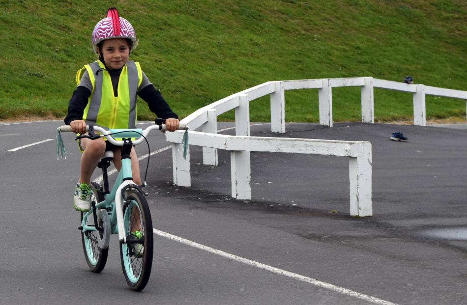 Jessica Barker (6), of Mosgiel, rides her bike at the Family Bike Day.