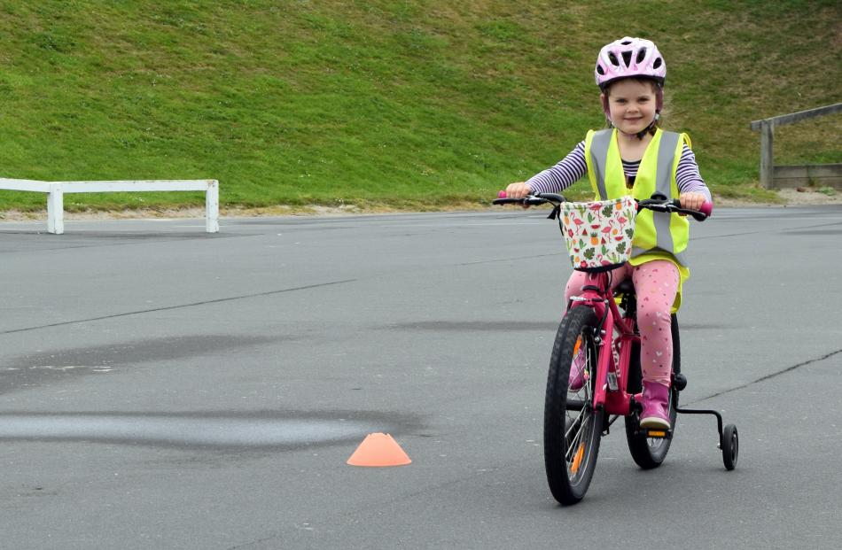 Madeline Read (5), of Tainui, rides her bike at Marlow Park in St Kilda on Sunday.