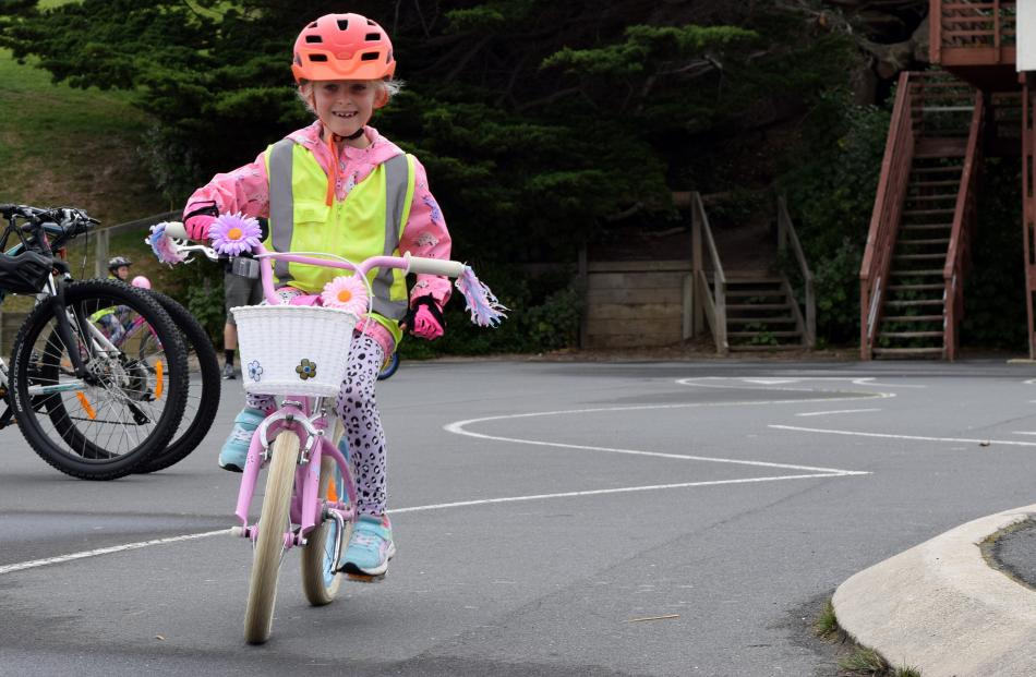 Camille Mirosa (6), of Woodhaugh, rides her bike in St Kilda on Sunday.