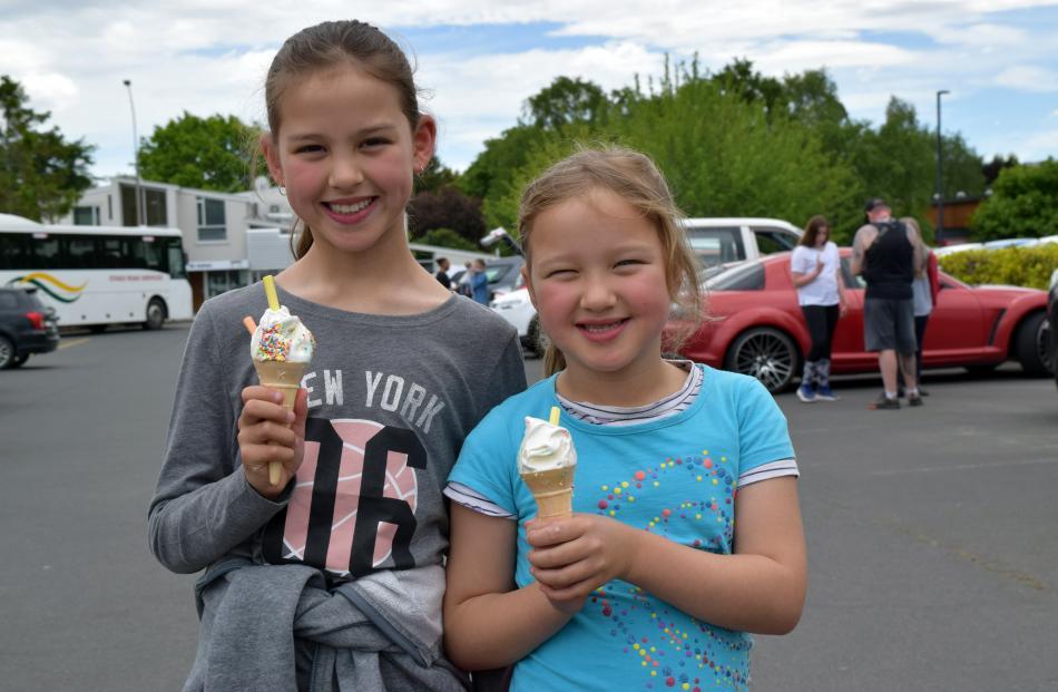 Sisters Lily (9) and Tia (6) Te Ngahue, of Belleknowes, eat ice cream.