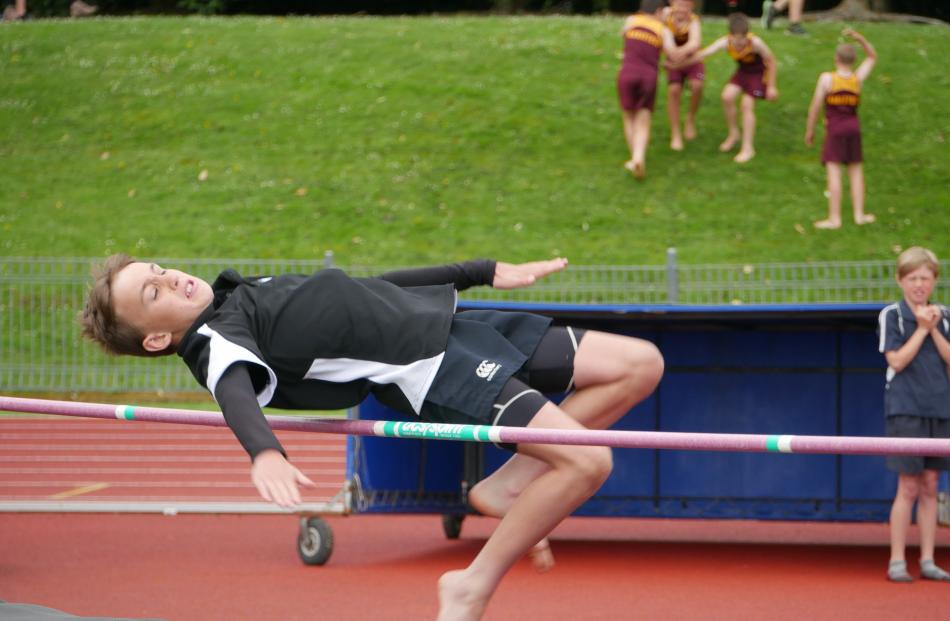 Lee Stream School pupil Charlie Nichol (10) makes it over the bar while competing in the under-11...
