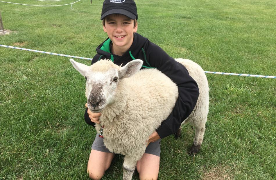 Senior lamb champion winner pupil Toby Benison (13), of Springston School, hugs his 14-week-old...