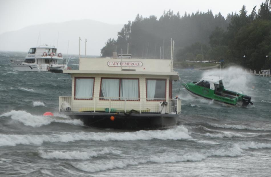 Catamaran Lady Pembroke was driven ashore from its mooring during high winds in Wanaka yesterday....