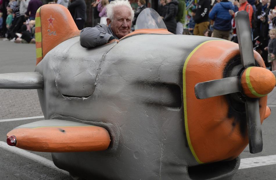 Trevor Macdonald drives his aeroplane float.