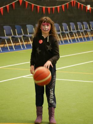 Alyssa Evans (10), of Dunedin, has her eyes on the hoop while playing basketball.