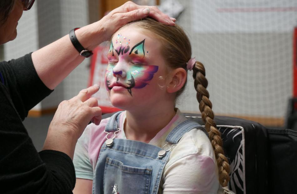 Emily Walton (7), of Abbotsford, has her face painted.