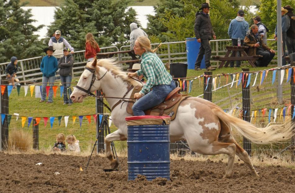 Megan Staples, of Alexandra, competes in the second division barrel race at the Millers Flat...