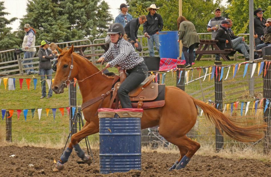 Natalie De Caro, of Lake Hawea, rounds a barrel in the Millers Flat Rodeo second division barrel...