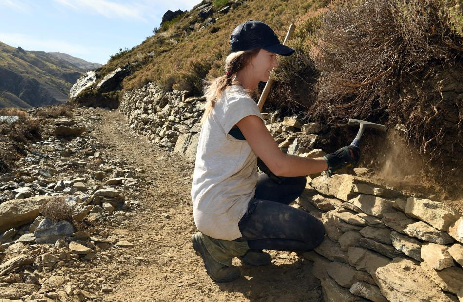 Briar Laurie, of Queenstown, stacks rocks along the Cromwell Gorge cycle trail. PHOTOS: STEPHEN...
