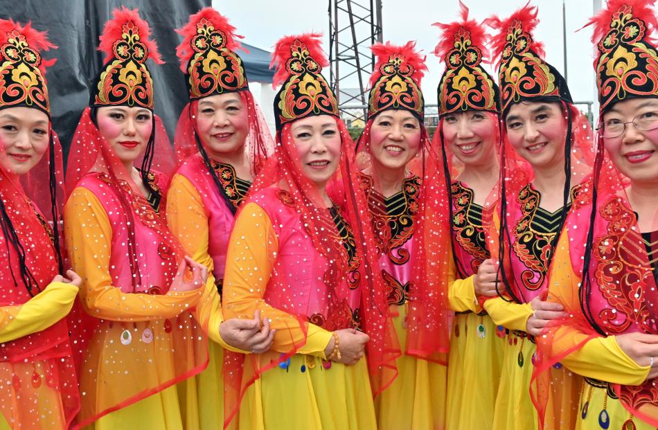 Dressed in traditional red and gold silk, members of the Dunedin Chinese and Arts Association...