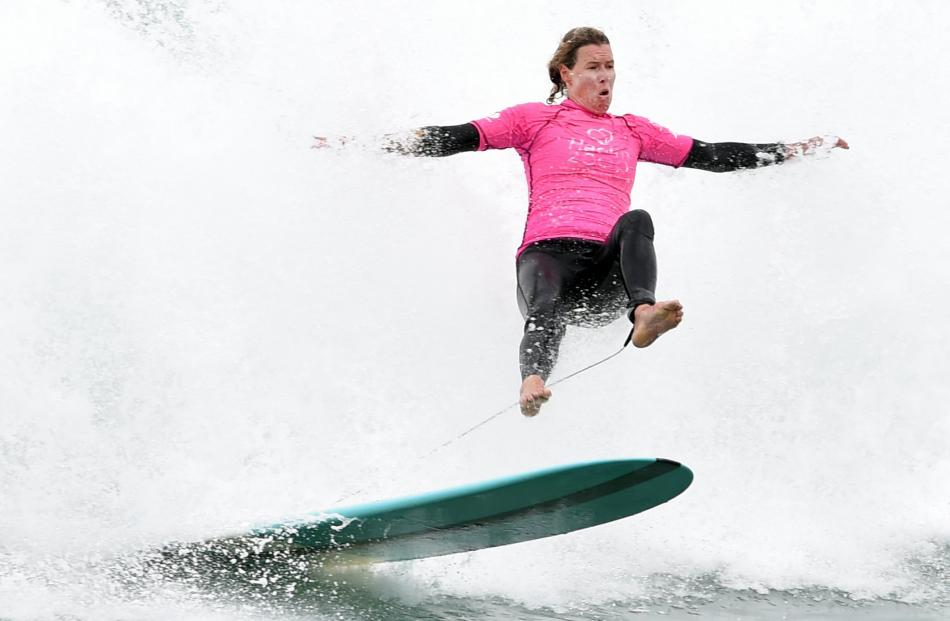 Donna Henderson, of Christchurch, seems startled as she is lifted off her board by the wave's...