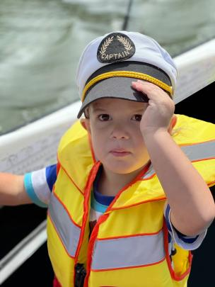 Arlo Condon (2) is boat captain on the Taieri River on December 27. PHOTO: KRISTAL CONDON