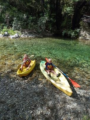 Kelly (5, left) and Angus (6) Moodie kayak in the Mill Flat, Marlborough, swimming hole after...