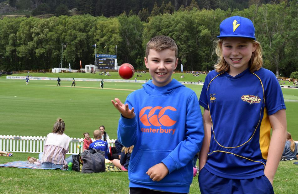 Sam Pool, of Mosgiel, throws a ball in the air with friend Emmi Murray, of Maori Hill (both 11).