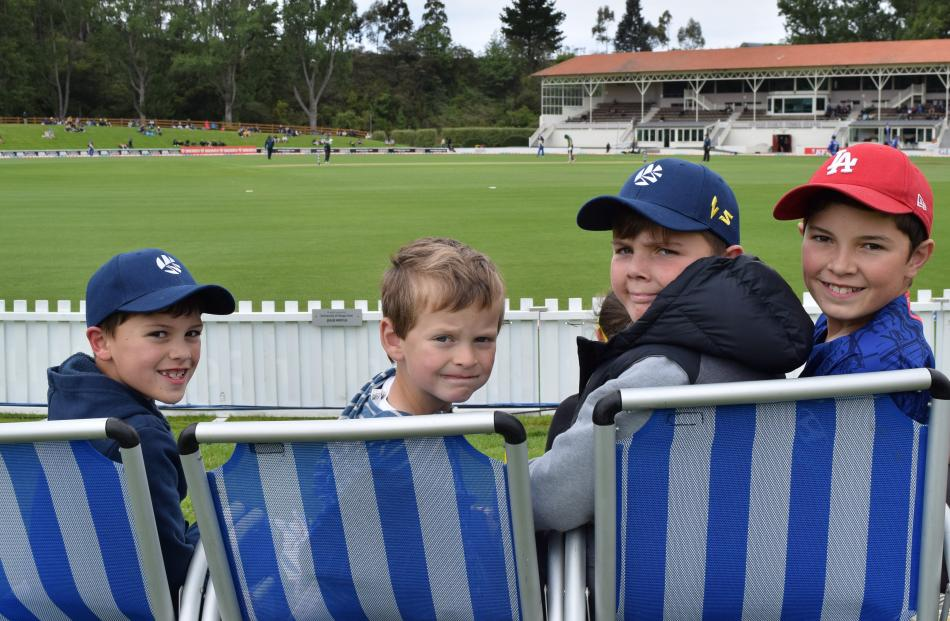 Watching the action from deck chairs are friends (from left) Quinn Hill, of Mosgiel and Harry...