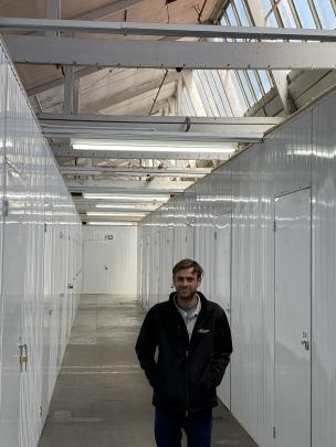 Mill Park industrial site manager Frank Offen is flanked by some of the 440 storage units which...