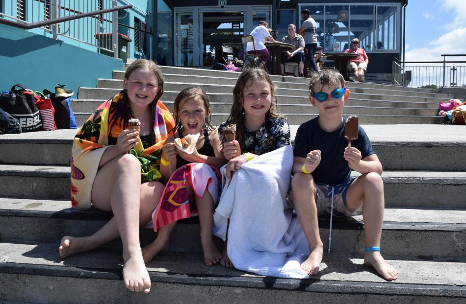 Having a bite to eat are (from left) Skye (11) and Molly Houghton (11), of Dunedin, Jayla Lindup ...