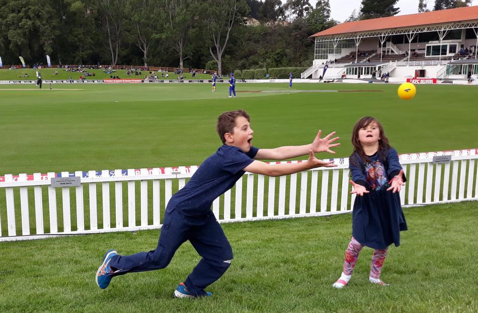 Lewis (9) and Libby (6) Maclennan practise their fielding skills while at the cricket at...