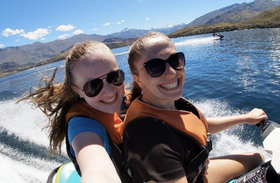 Dunedin girls Kaitlyn Marsh (16, left) snaps a photo of herself ...