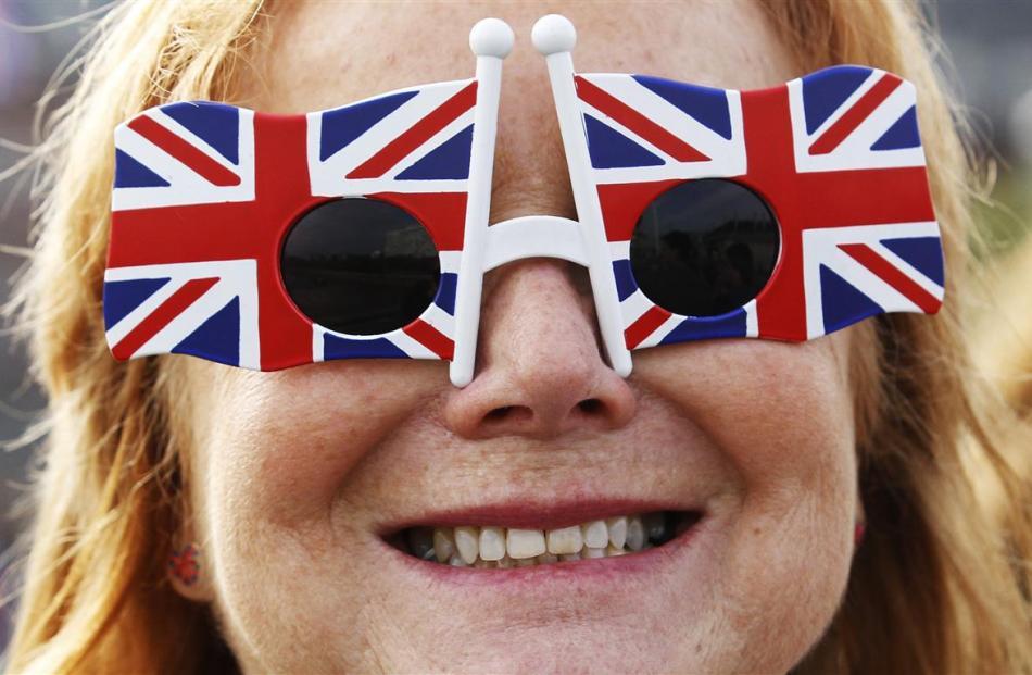 A woman wears Union Flag sunglasses in London .  REUTERS/Luke MacGregor