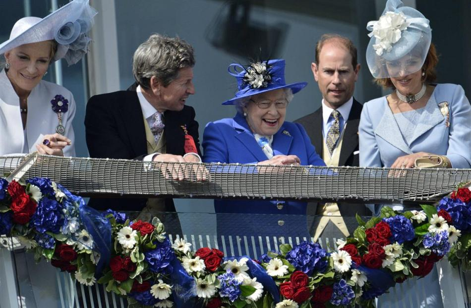 Queen Elizabeth smiles after the Epsom Derby horse race at at the launch of four days of...