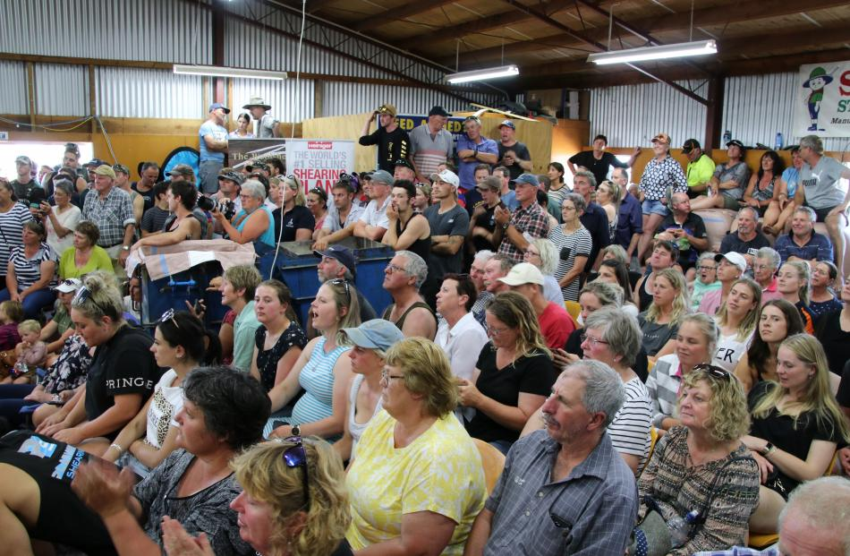 Grant's woolshed was filled with spectators who clapped and shouted encouragement to Megan...