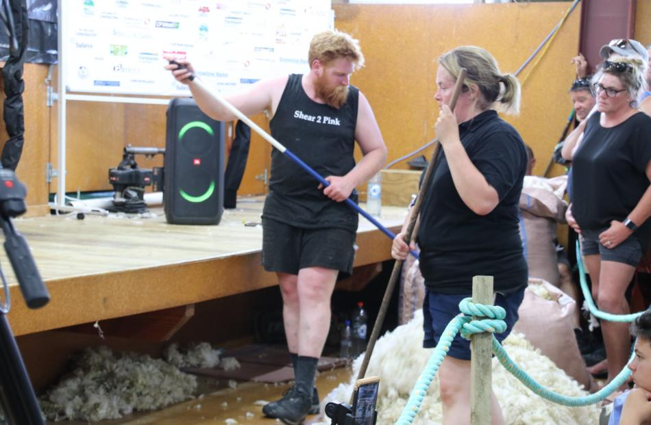 Woolhandlers (from left) John Hunter, Callie Callahan and Tracey Calder were busy keeping the...
