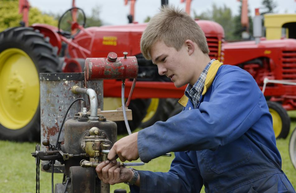 Otago Vintage Machinery Club member Max Martin, of Saddle Hill, makes sure a 1928 Anderson engine...
