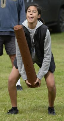 Ryleigh Makiiti (13), of Dunedin, tosses the caber at the Caledonian Society of Otago events....