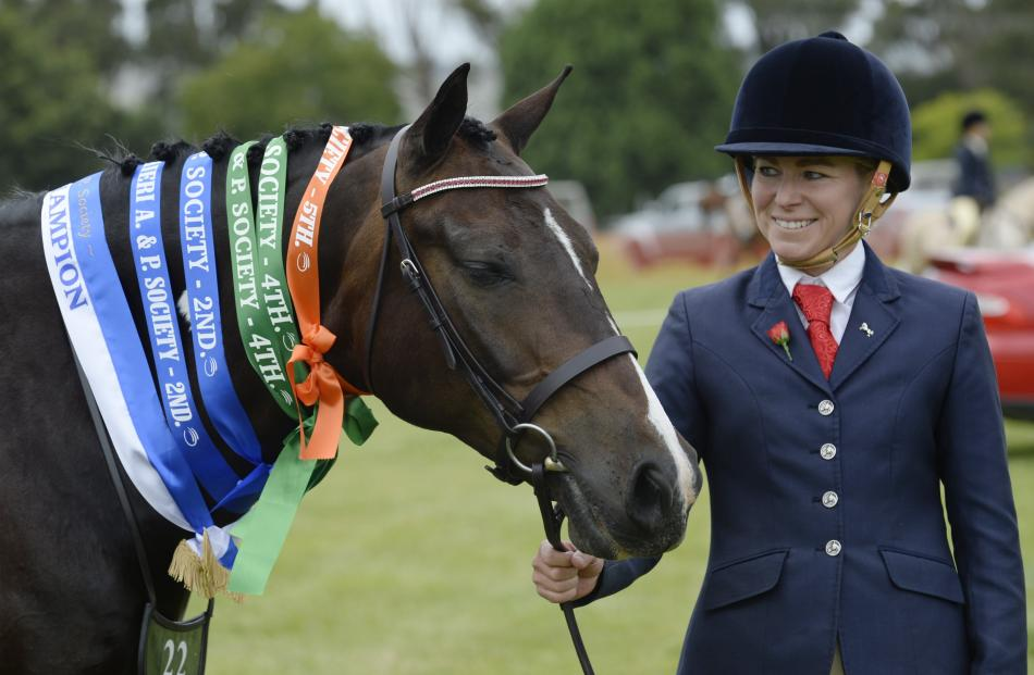 Amanda Campbell, of Alexandra, and her 10-year-old pinto Enzo Ferrari celebrate their riding...