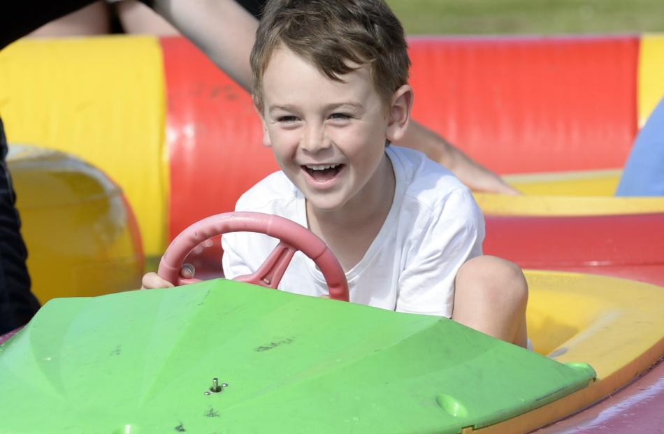 Sam Cockburn (5), of Dunedin, enjoys a ride in a bumper boat.