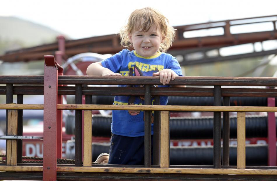 Jax Head (2), of Dunedin, checks out a vintage fire engine.