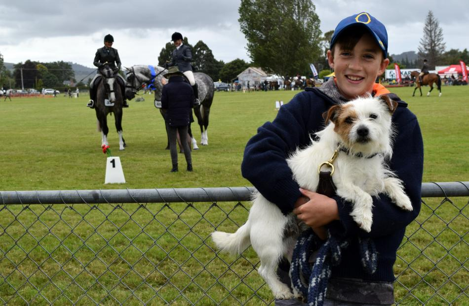 Watching an equestrian event are Charlie Nicol (10), of Lee Stream, and his Jack Russell terrier,...