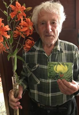 Henri La Rooij (85), of North East Valley, with his first-ever entry in a flower show. The tiger...