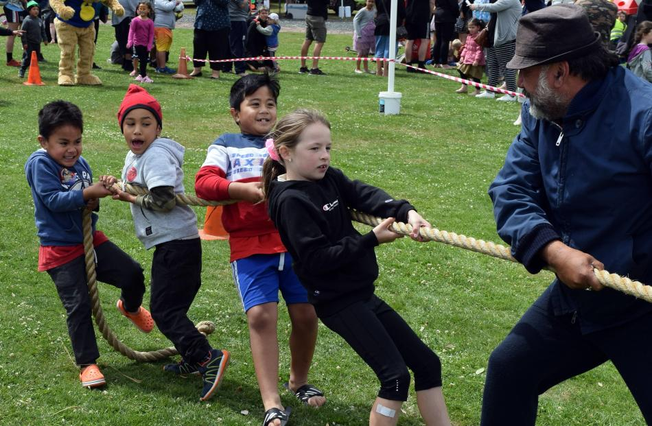 Competing in a tug-of-war are (from left) Sio Tofilau (4), Ezra Namana (5), JT Tofilau (7), Lucy...