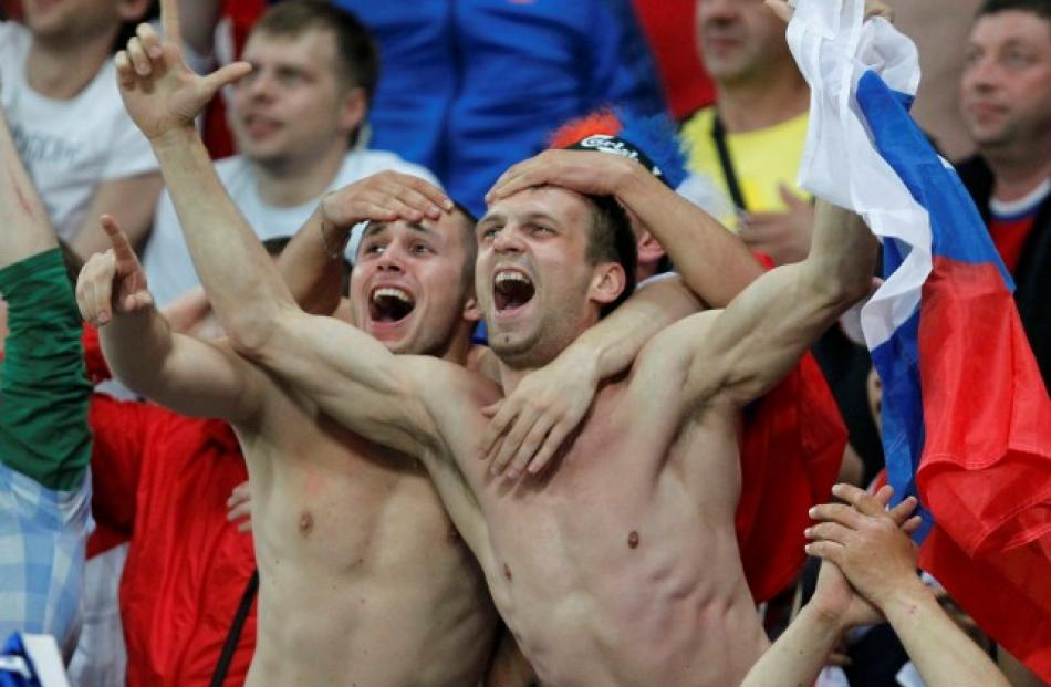 Russian supporters celebrate their team's 4-1 win over the Czech Republic 4-1 at the City Stadium...